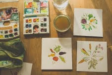 Ashley's art, find pen and watercolor pieces features in Homeward Bounty Seed packets.