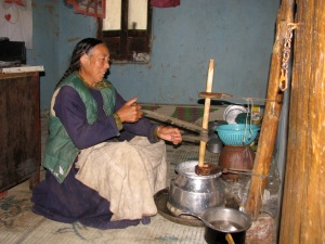 My host mother, making butter. A task that was done every morning.